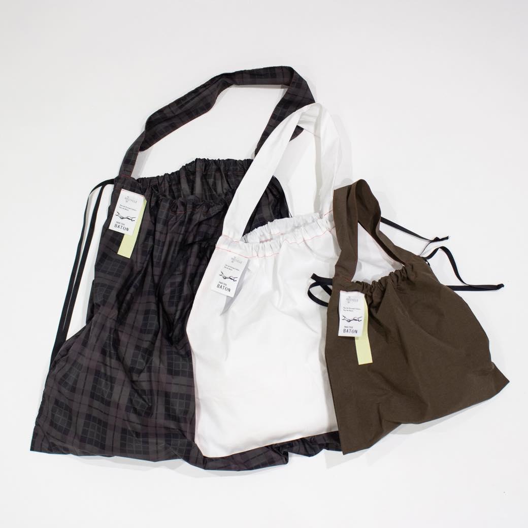 エコバッグもストーリーで選ぶ。デッドストック生地を使った「PASS THE BATON」の巾着型バッグ